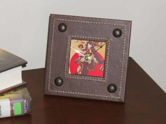 """Cowgirl Clock 1$30.00 Battery operated clock, leatherette & printed graphic,  5.75"""" x 5.75""""  Price $30.00"""