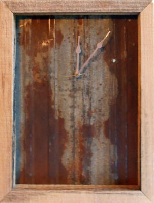 """Barn Wood Clock Style 1  Barn Wood and rusted steel clock with quartz electric movement This example is 12"""" tall x 8"""" wide x 3"""" deep  Price $100"""
