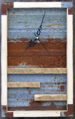 """Barn wood and rusted steel clock with hammered steel corners  & quartz electric movement This example is barn wood & rusted steel roofing    12"""" tall x 8"""" wide x 3"""" deep  Price $ 125"""