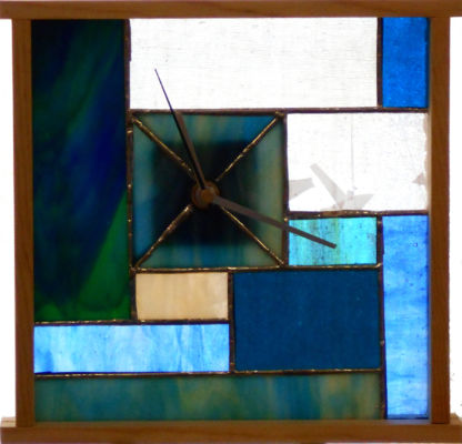 """Stained glass window clock with quartz electric movement The example is 8"""" tall x 8"""" wide pine & stained glass  Price $ 125.00"""